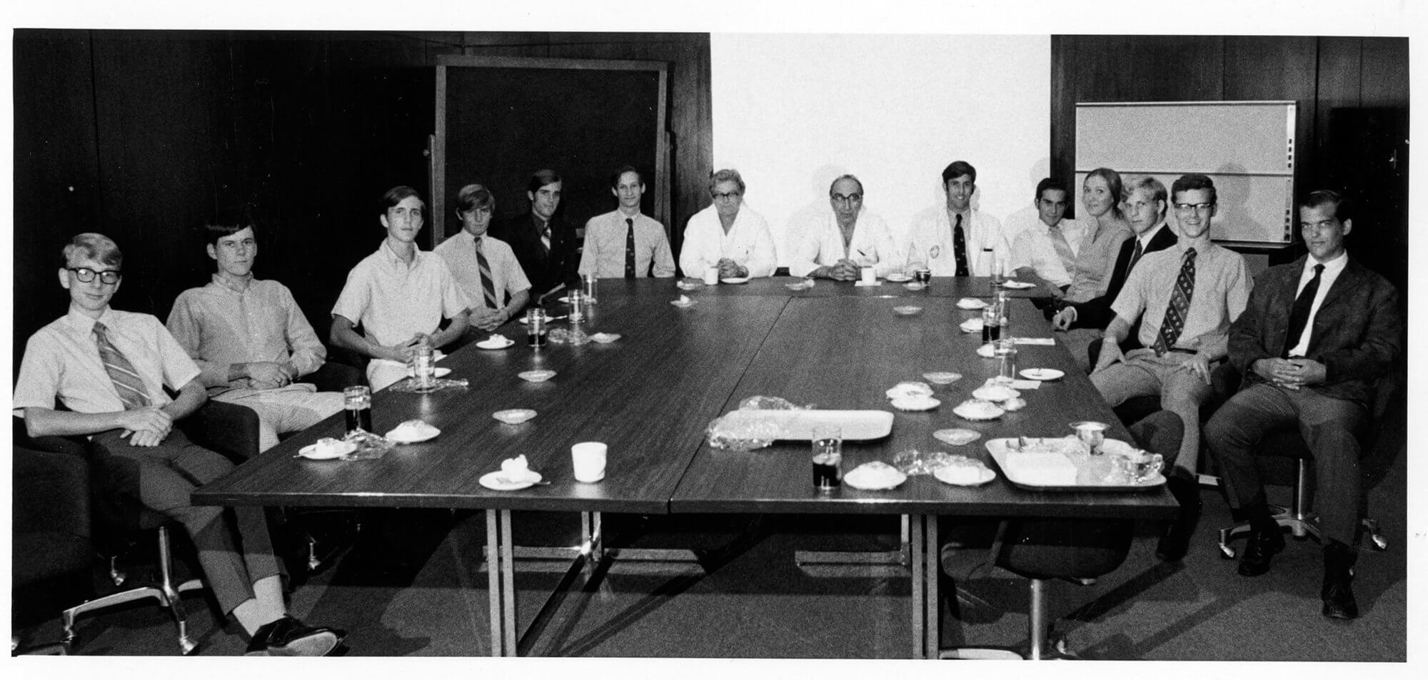 Michael E. DeBakey, M.D., center, surrounded by students in the summer surgery program in 1970.