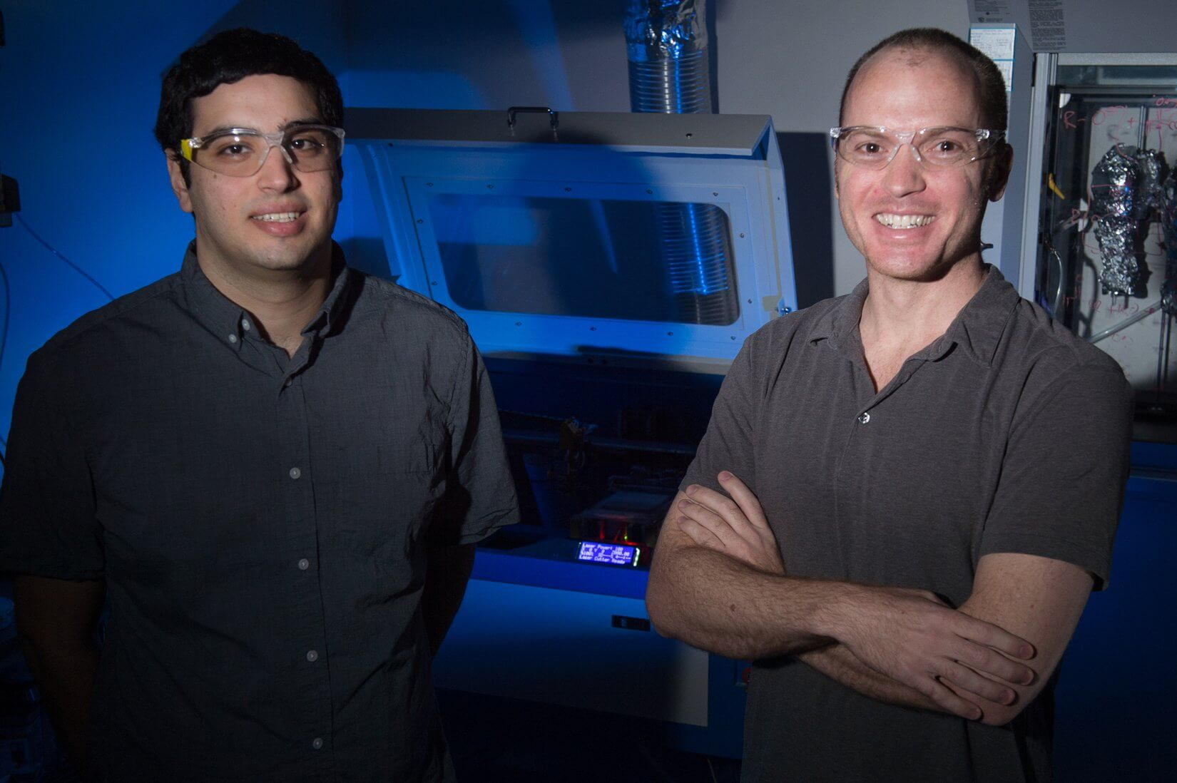 Ian Kinstlinger (left) and Jordan Miller with the OpenSLS printer. Design specs and performance for OpenSLS are available at https://github.com/MillerLabFTW/. (Photo by Jeff Fitlow/Rice University)