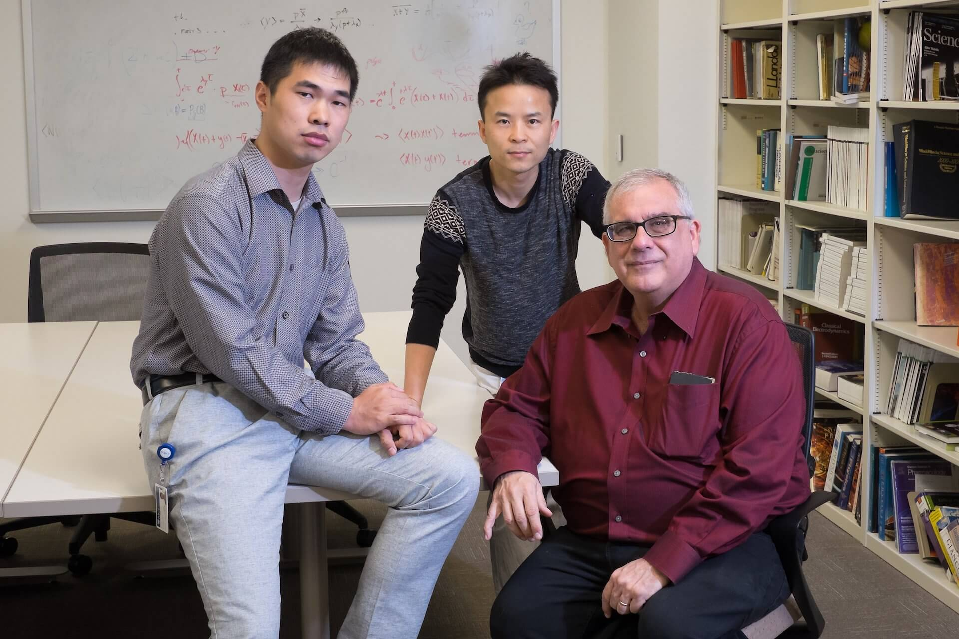 From left, Rice University graduate student Mingchen Chen, postdoctoral researcher Weihua Zheng and theoretical biological physicist Peter Wolynes co-authored a paper explaining a complex feedback loop between actin filaments and aggregating proteins in neurons that appears to be key to the formation of long-term memories. (Credit: Jeff Fitlow)