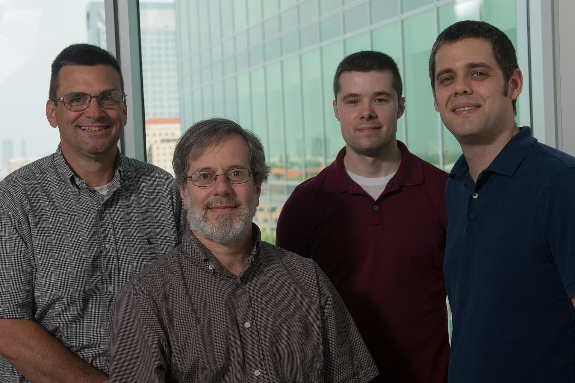 A four-year study by Rice University biochemists (from left) James McNew, Michael Stern, James Summerville and Joseph Faust has revealed specific neuronal defects that arise from two genetic defects known to cause hereditary spastic paraplegia. (Photo by Jeff Fitlow/Rice University)
