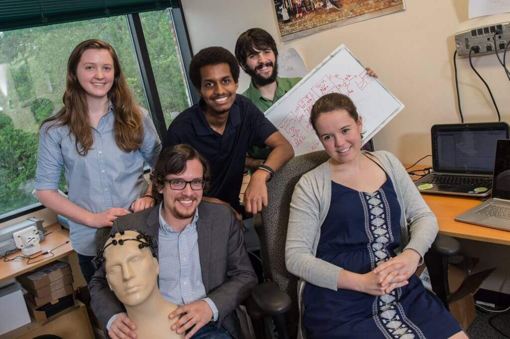 Rice University engineering students have developed an algorithm to analyze brainwaves for early signs of an epileptic seizure. Clockwise from top left: Sarah Hooper, Michael Tsehaie, Victor