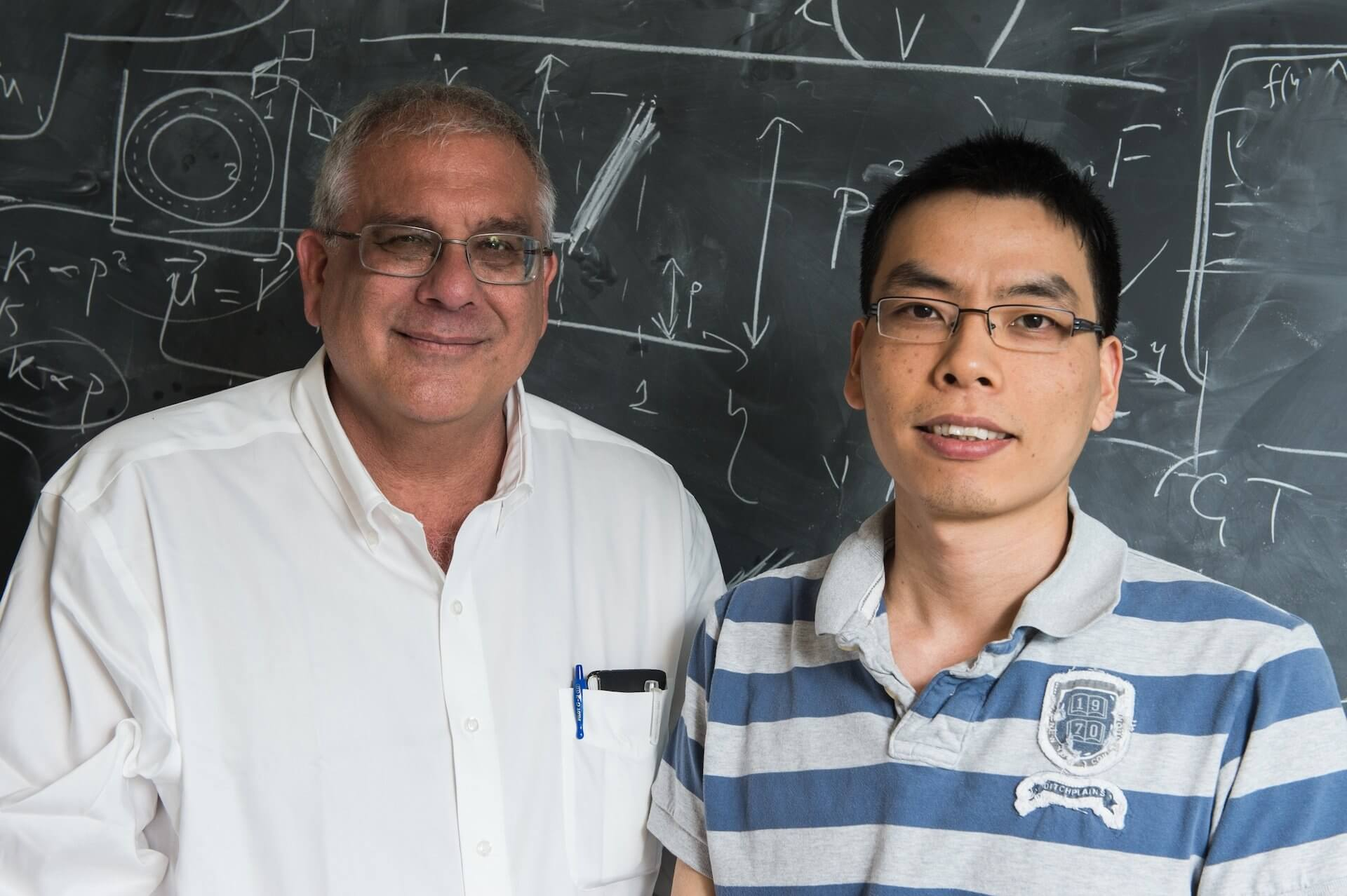 Rice University researchers Peter Wolynes, left, and Bin Zhang are working to formulate an energy-landscape theory for chromosomes. (Credit: Jeff Fitlow/Rice University)