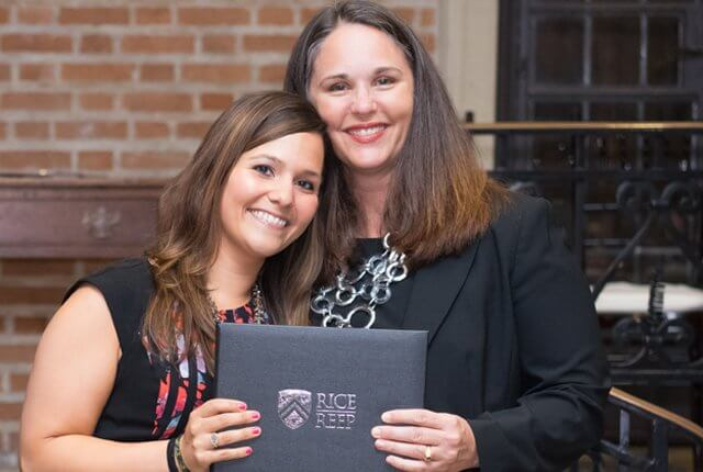 REEP Executive Director Andrea Hodge congratulates Lauryn Cruz, a middle school English language arts lead at Houston's St. Francis of Assisi Catholic School, on graduating from REEP's MBA program at a May 12 ceremony at Rice's Cohen House.