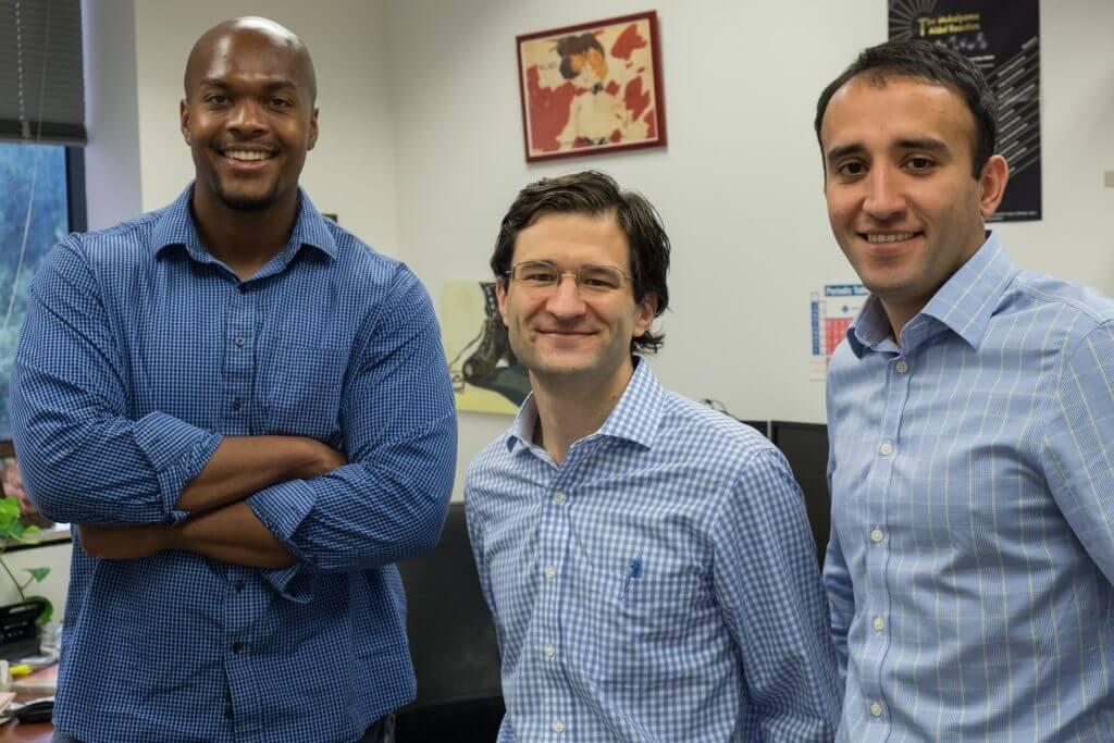 From left to right, graduate student Matthew Minus, Associate Professor Zachary Ball and graduate student Farrukh Vohidov.