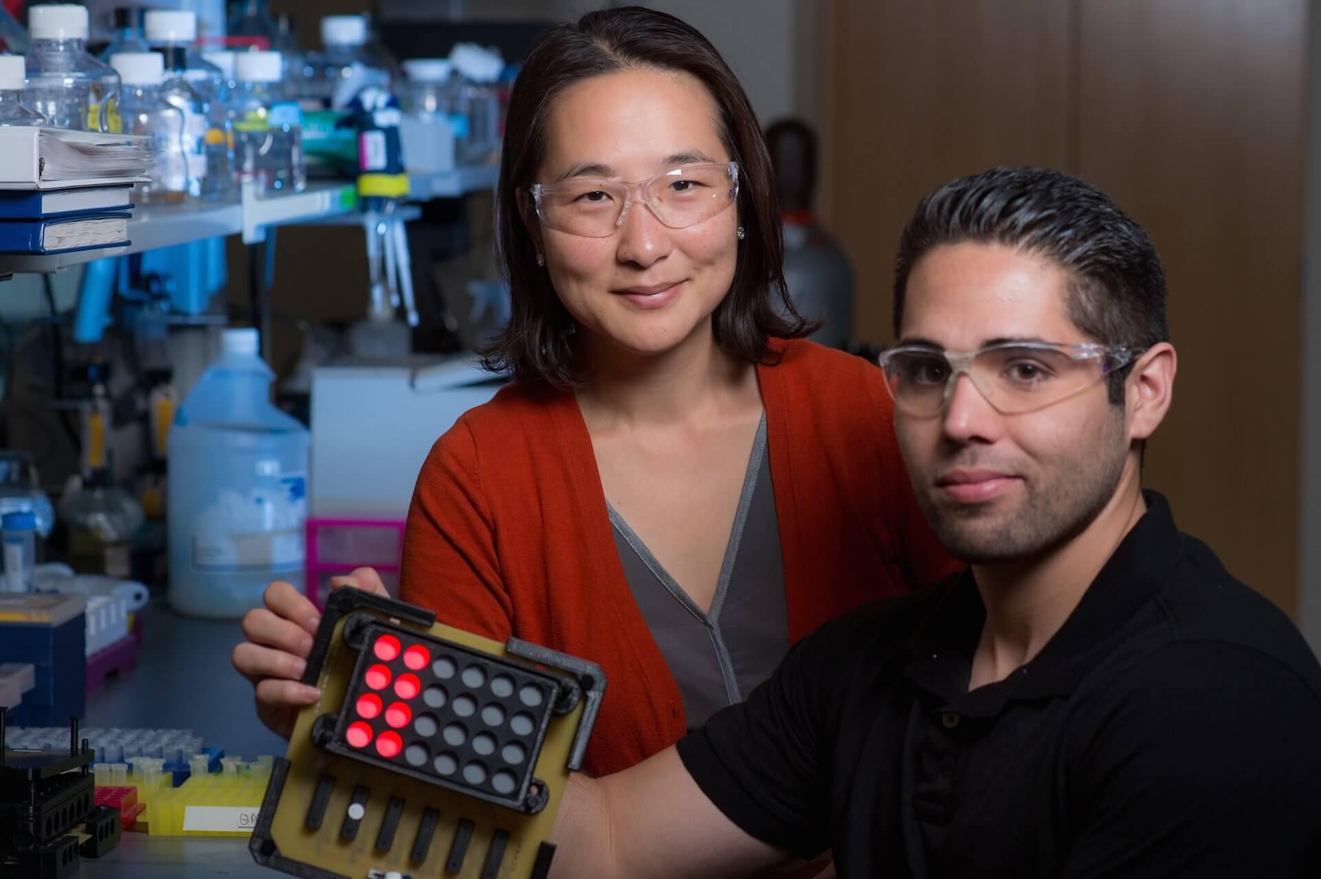 Rice University bioengineer Junghae Suh, left, and graduate student Eric Gomez. (Credit: Jeff Fitlow)