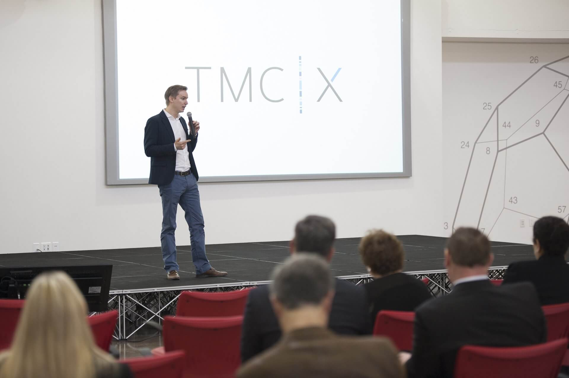 Alexander Schueller, president of  Adhesys Medical, presenting on stage at TMCx.