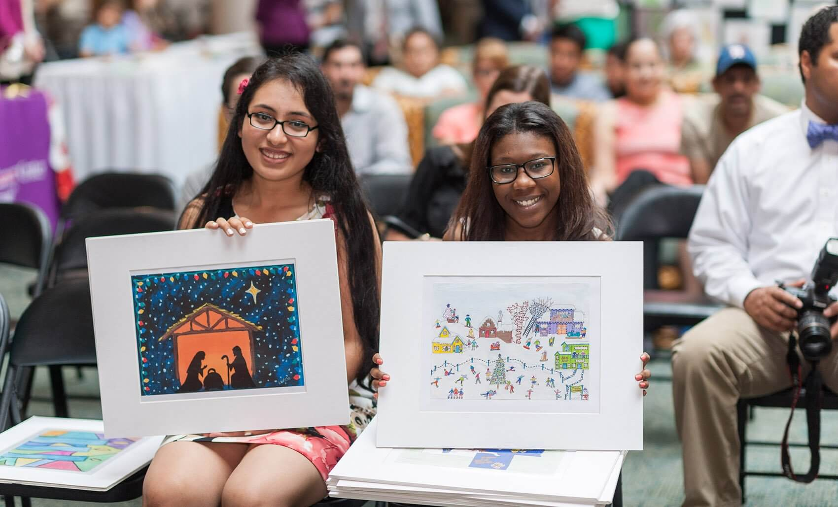 Leticia Torres and Kierra Hill with their designs. (Credit: MD Anderson Cancer Center)