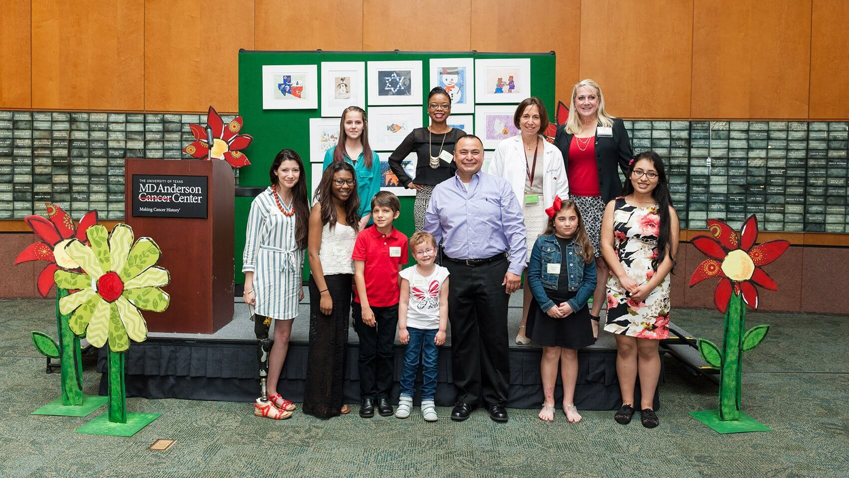 The young artists, pictured with Cindy Schwartz, M.D., Shannan Murray and Leon Benavides. (Credit: MD Anderson Cancer Center)