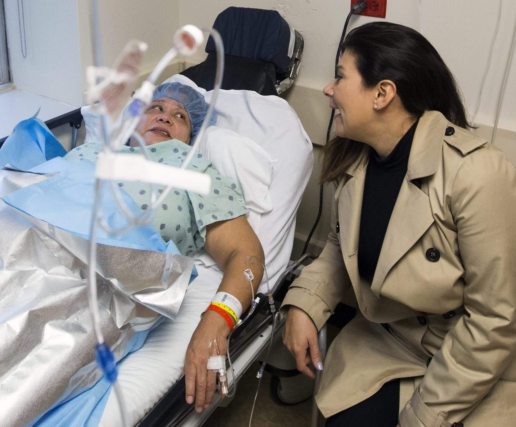 Lidia Lopez visits with her daughter, Victoria, before eye surgery.