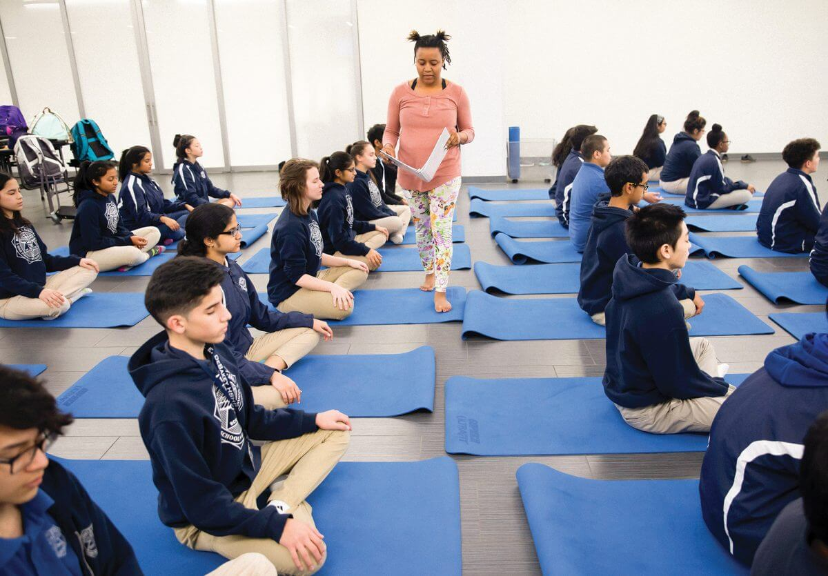 Ninth-graders at DeBakey High School practice yoga with instructor Amber Foster (Credit: Annie Mulligan).