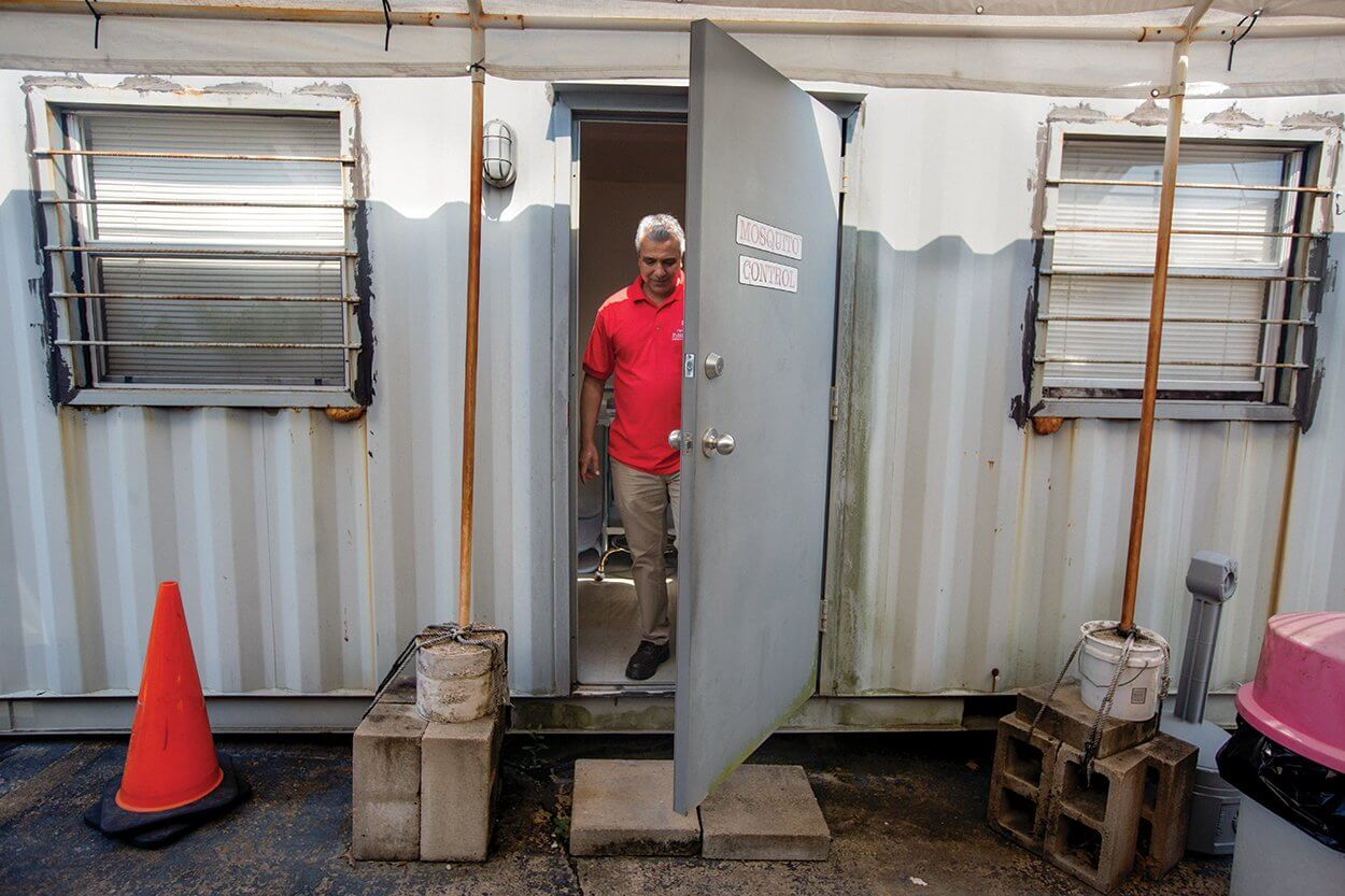 Mustapha Debboun, Ph.D., director of the mosquito and vector control division at Harris County Public Health, stands inside one of the county's mobile mosquito laboratories.