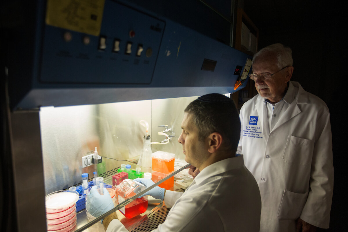 Yosef Gilad, Ph.D., left, a postdoctoral associate in Baylor's Department of Molecular and Cellular Biology, works with Bert O'Malley, Baylor chancellor.