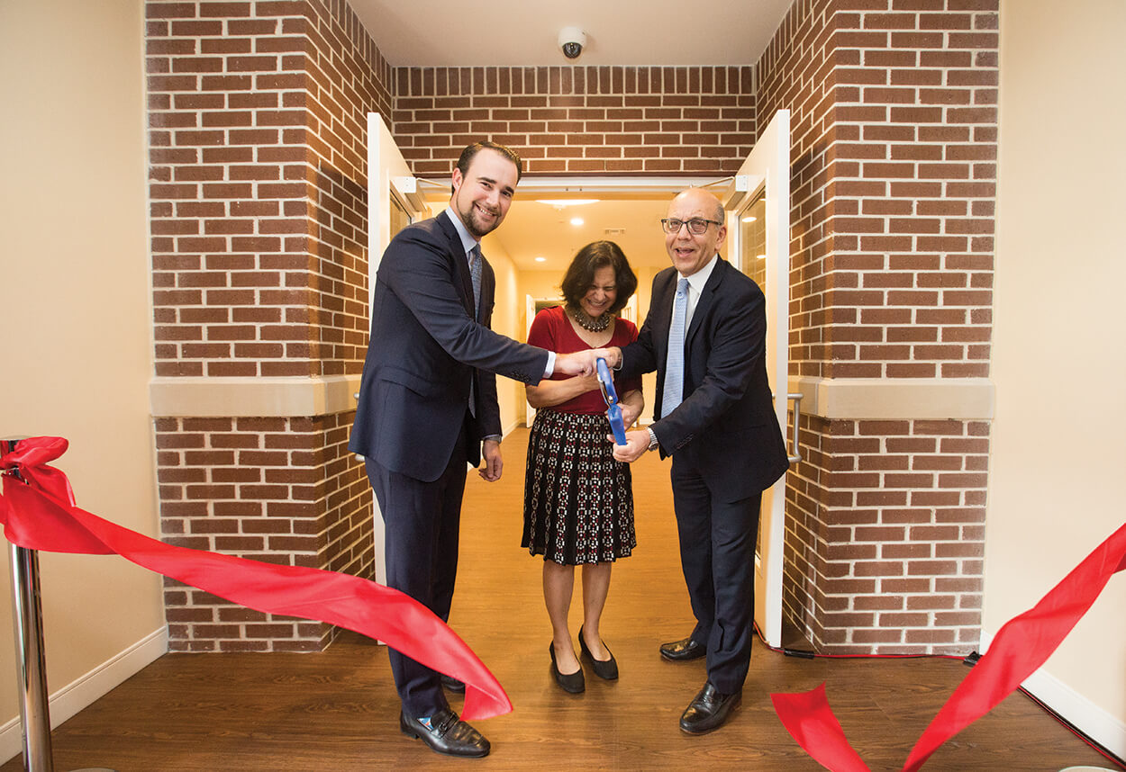 SHAWN W. CLOONAN, chief operating officer and executive vice president of the TMC, joins Nora's Home founders LILLIAN GABER, M.D., associate medical director of renal pathology at Houston Methodist Hospital, and her husband, OSAMA GABER, M.D., director of Houston Methodist J.C. Walter Jr. Transplant Center and the J.C. Walter Jr. Presidential Distinguished Chair, at a ribbon cutting ceremony for an expansion of Nora's Home that doubles its capacity.