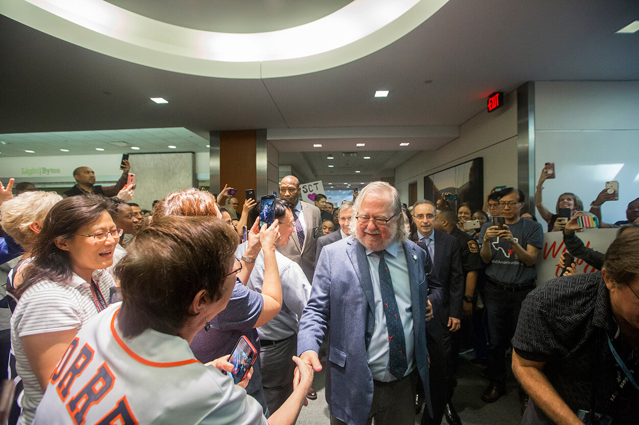 James P. Allison, Ph.D., an immunologist at The University of Texas MD Anderson Cancer Center who was jointly awarded the 2018 Nobel Prize in Physiology or Medicine  this week, celebrates with a parade through MD Anderson's Main Building on Oct. 5, 2018. (Credit: Cody Duty, TMC News)