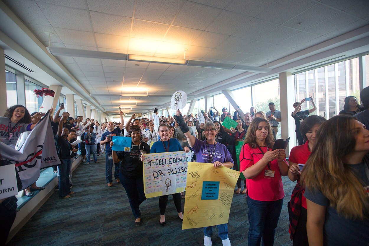 Well-wishers celebrate James P. Allison, Ph.D., an immunologist at The University of Texas MD Anderson Cancer Center who was jointly awarded the 2018 Nobel Prize in Physiology or Medicine this week, during a parade through MD Anderson's Main Building on Oct. 5, 2018. (Credit: Cody Duty, TMC News)