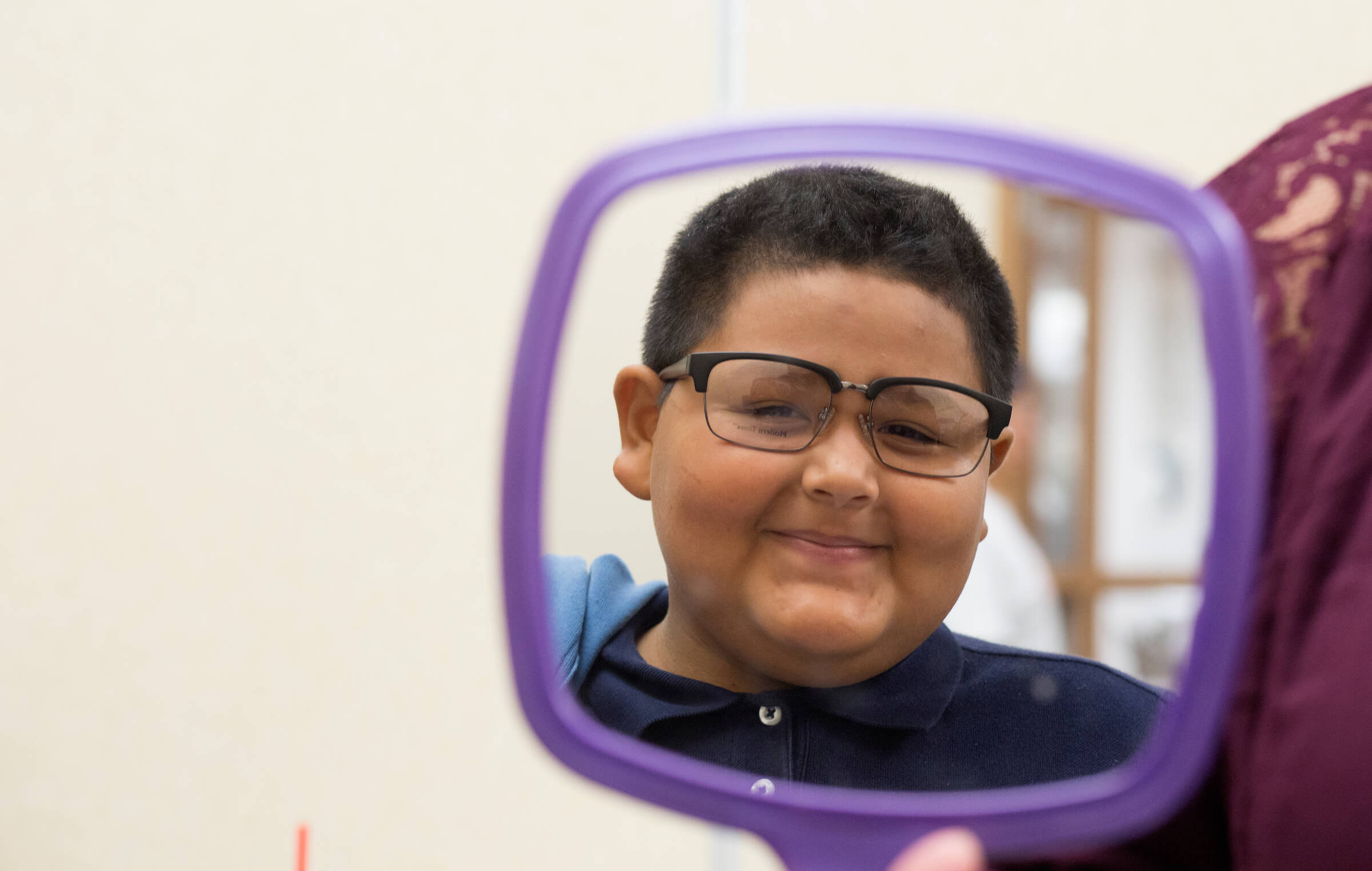 Francisco Perez tries on a pair of glasses during a