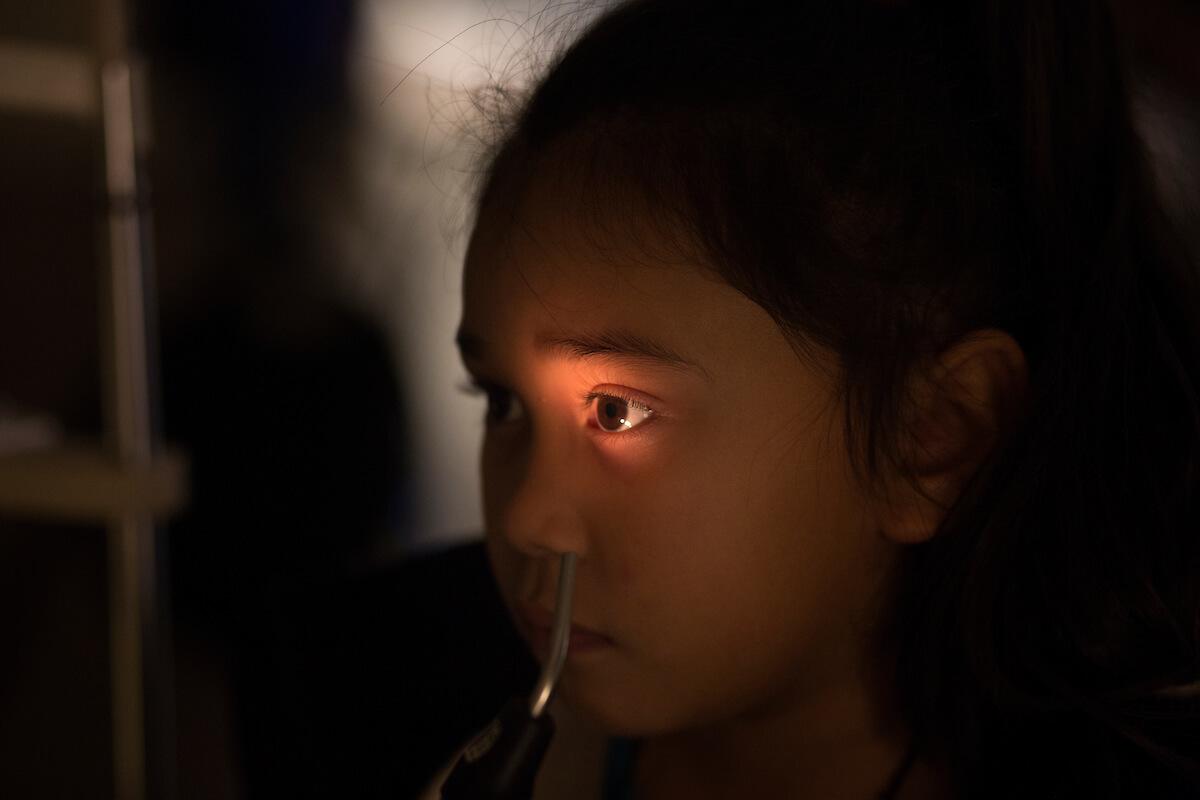 Jazmine Sanchez receives an eye exam during