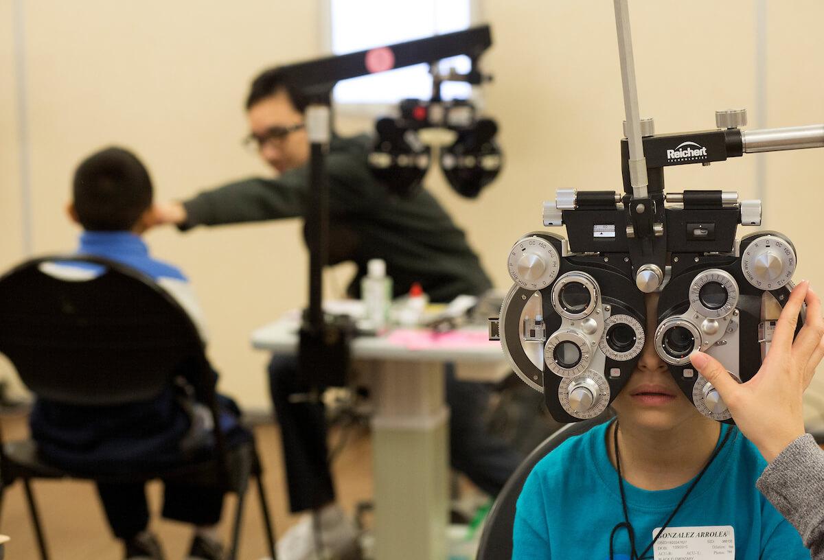 Arrolea Gonzalez receives an eye exam during