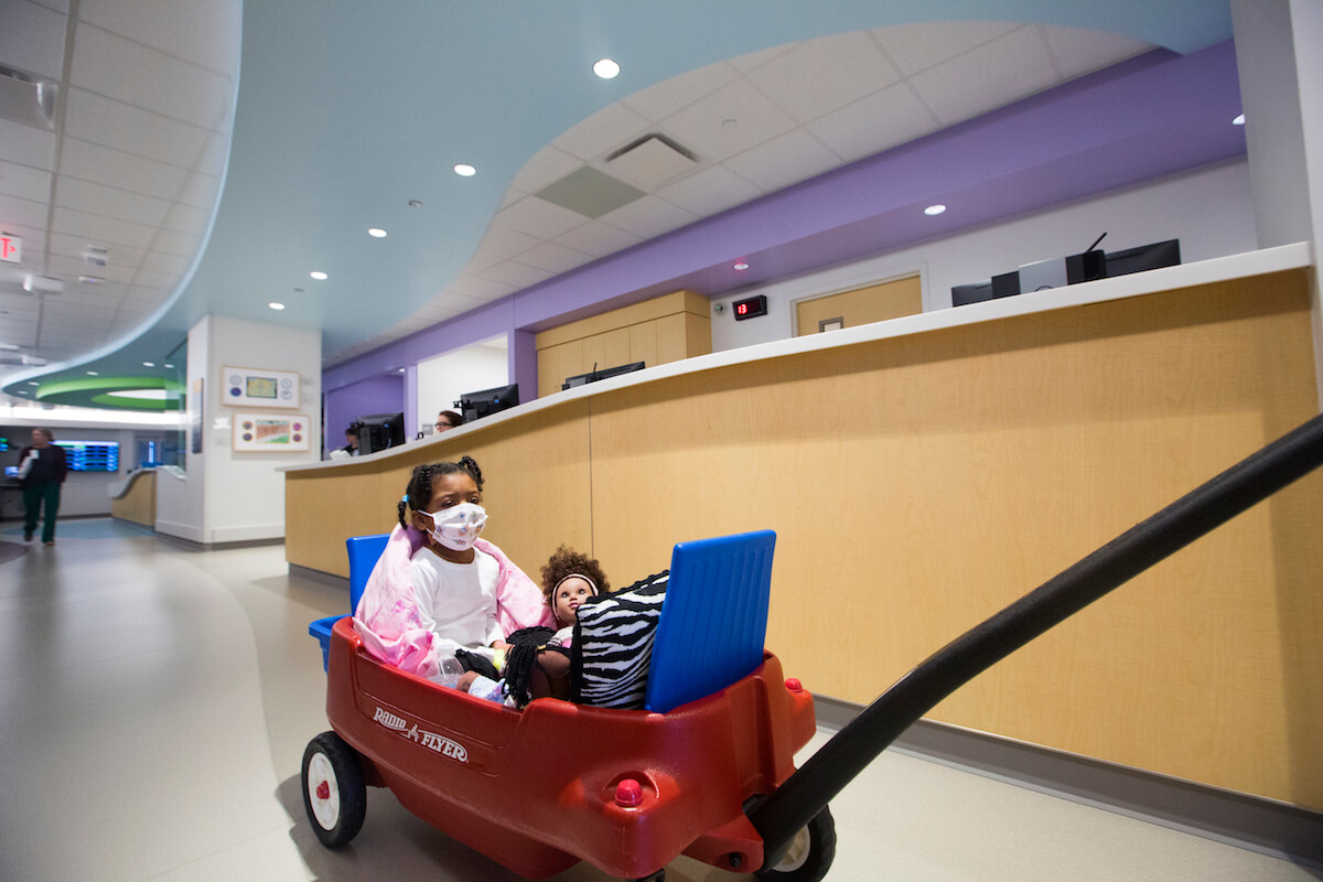 Hickman gets a ride to the playroom at Texas Children's Hospital.