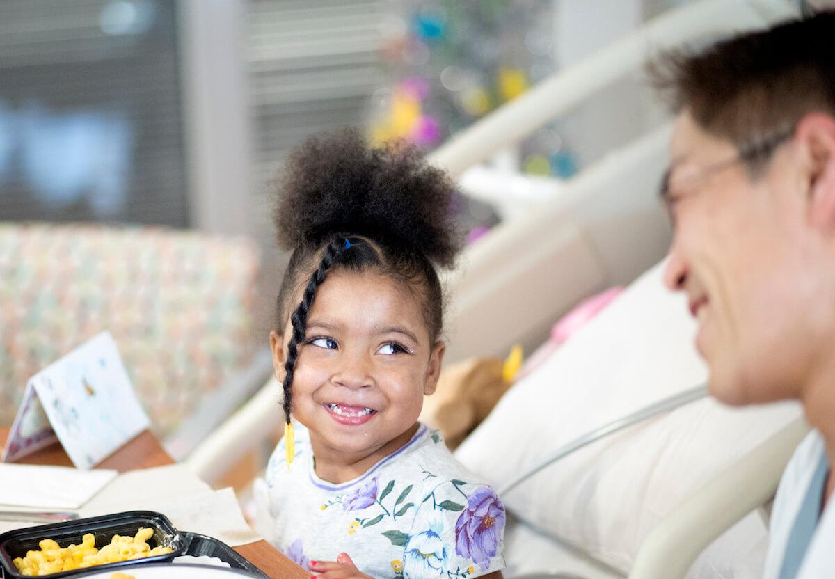 Katlyen Hickman enjoys lunch at Texas Children's Hospital with congenital heart surgeon Iki Adachi, M.D.