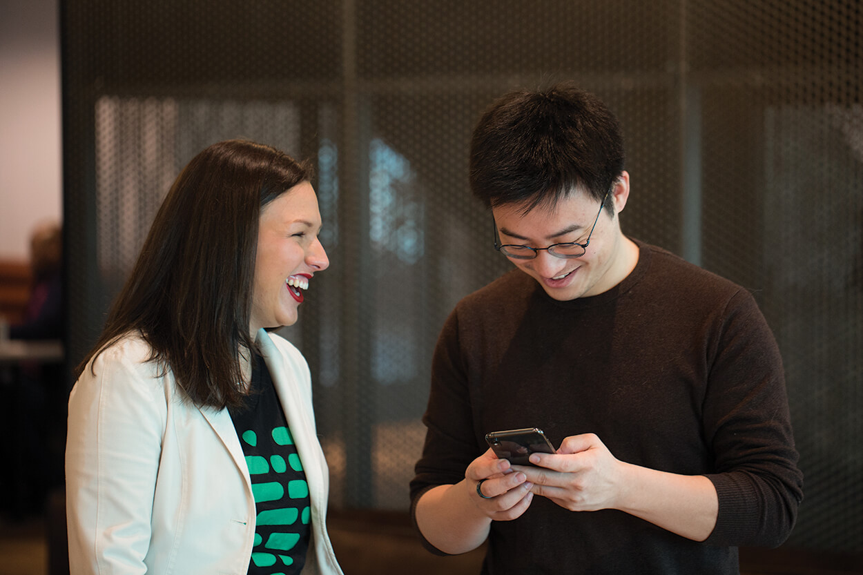 Barreto and Bin Huang, Ph.D., co-founder and chief technological officer of Pheramor, share a laugh.