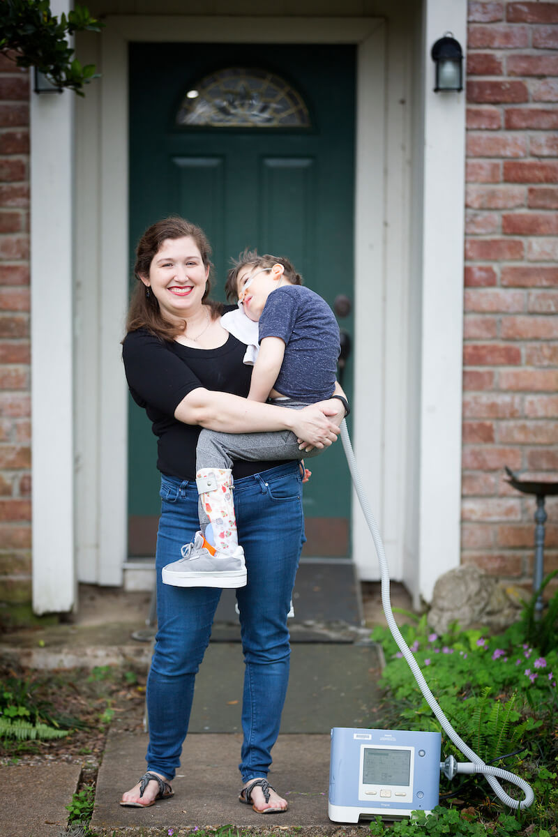 Cheryl Lingenfelter holds her son outside their Sugar Land home.