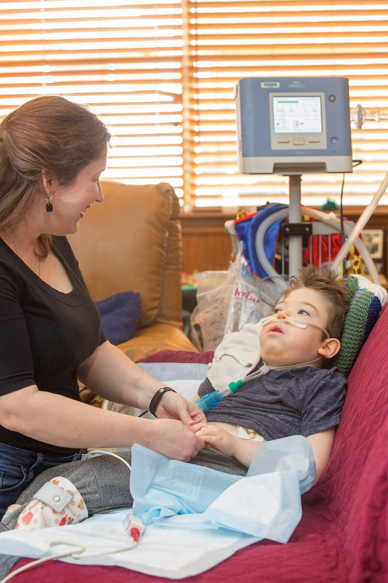 Cheryl Lingenfelter cares for her son, 6-year-old Nathan Lingenfelter, who is part of the UT Physicians High Risk Children's Clinic's telemedicine study.