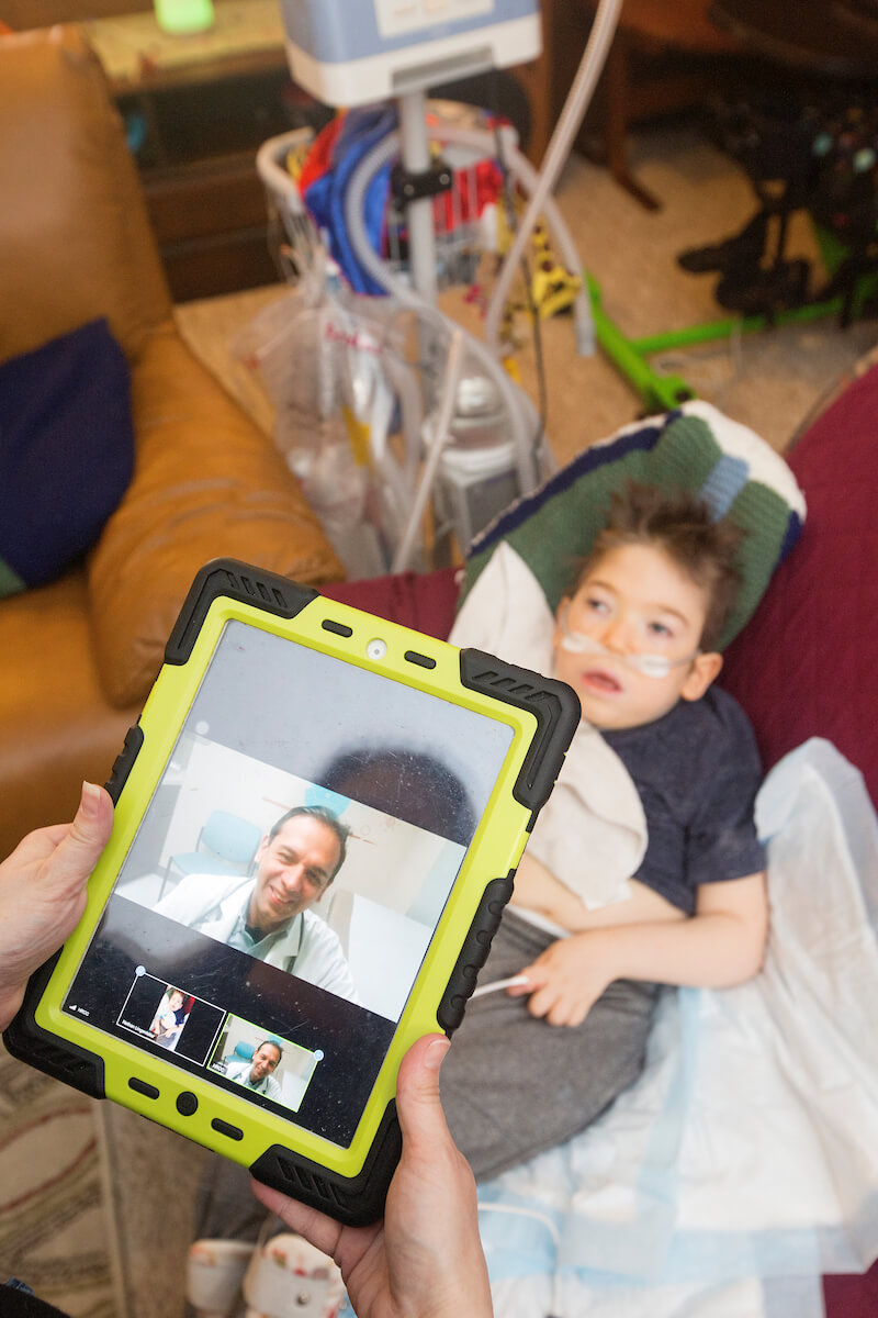 Nathan Lingenfelter, 6, has a virtual medical appointment at home in Sugar Land with pediatrician Ricardo Mosquera, M.D. facilitated by the child's mother, Cheryl Lingenfelter on March 12, 2019.