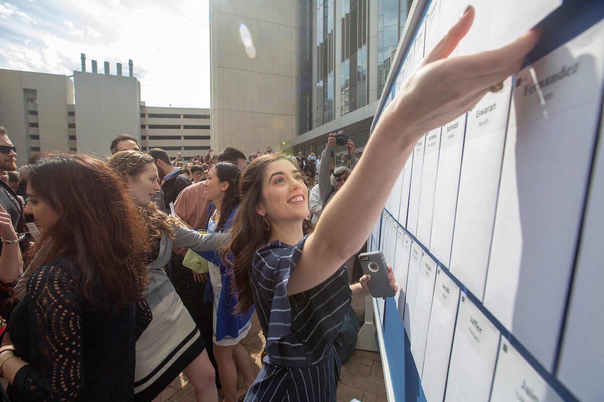 A student reaches for her envelope during Match Day at Baylor College of Medicine on March 15, 2019. In all, 158 fourth-year medical students from the program were matched with residencies.