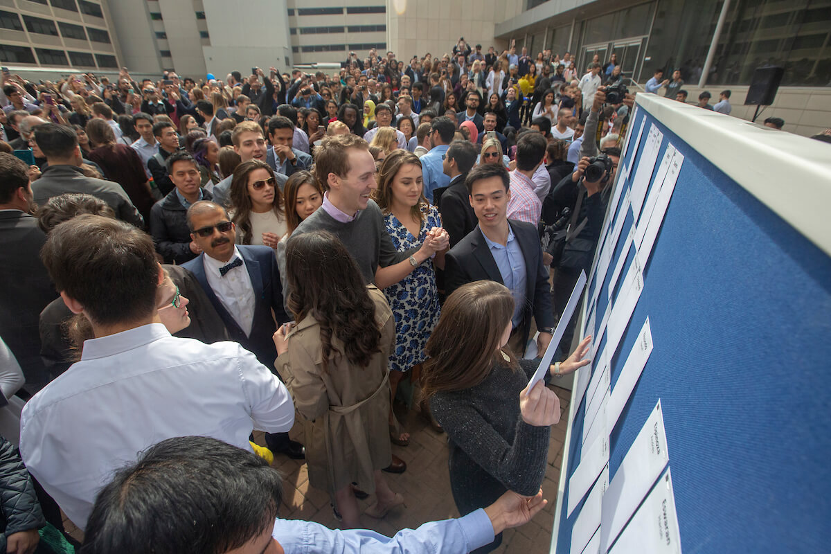 Students grab their envelopes during Match Day at Baylor College of Medicine on March 15, 2019. In all, 158 fourth-year medical students from the program were matched with residencies.