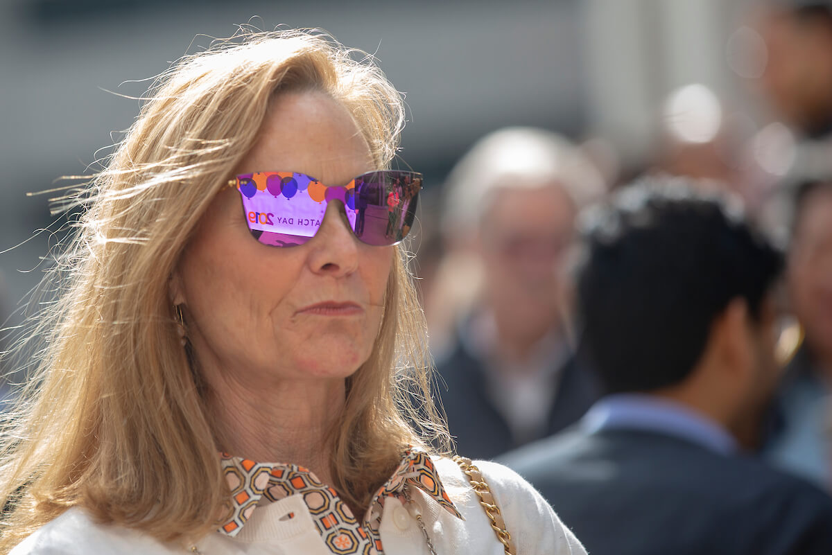 The Match Day poster is reflected in the sunglasses of Brenda Anderson as she waits in support of her daughter, Elizabeth Anderson, during Match Day at Baylor College of Medicine on March 15, 2019.