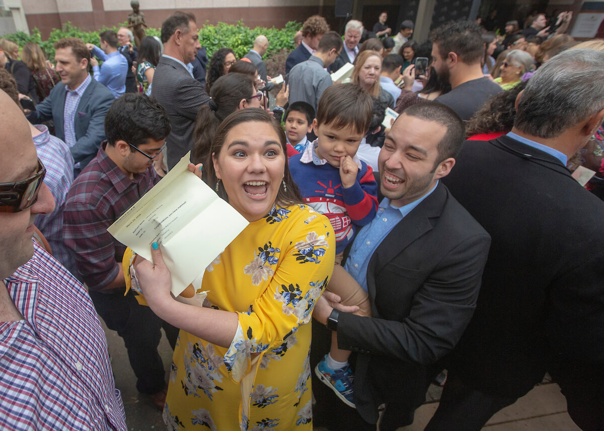 Deborah Martinez reacts after opening up her envelope aside her husband, Daniel, and their son, Anthony, during Match Day at UTHealth's McGovern Medical School on March 15, 2019.