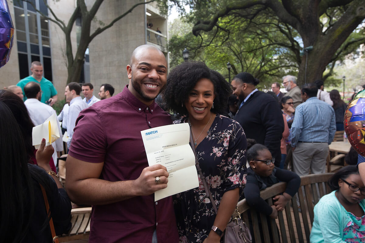 Raheim Turner, left, celebrates with Lisa Hanna, right, during Match Day at UTHealth's McGovern Medical School on March 15, 2019.