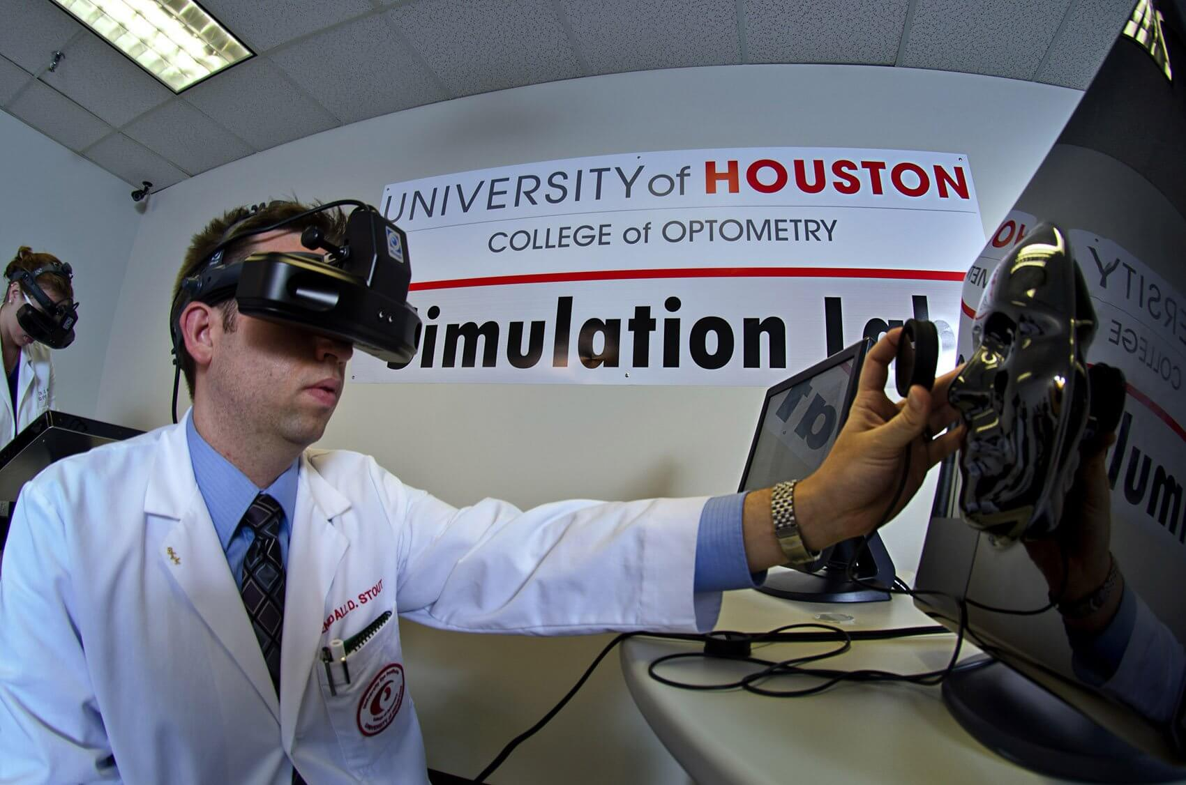 A UH College of Optometry student practices examining the retina of a virtual patient with an Eyesi ophthalmoscope in the new Optometric Clinical Skills Simulation Lab. (Credit: David Gee)