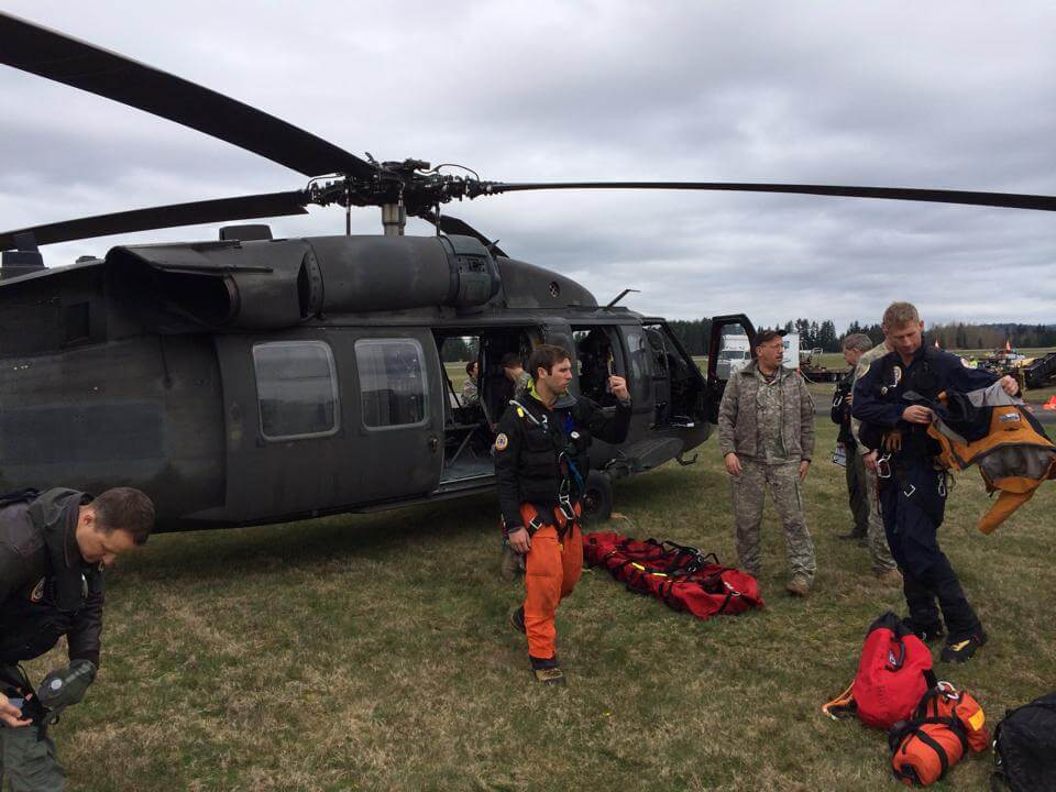 During the 2014 Oso mudslide incident, McDonough (center) and his team worked hand-in-hand with the Washington National Air Guard to conduct rescue and recoveries.