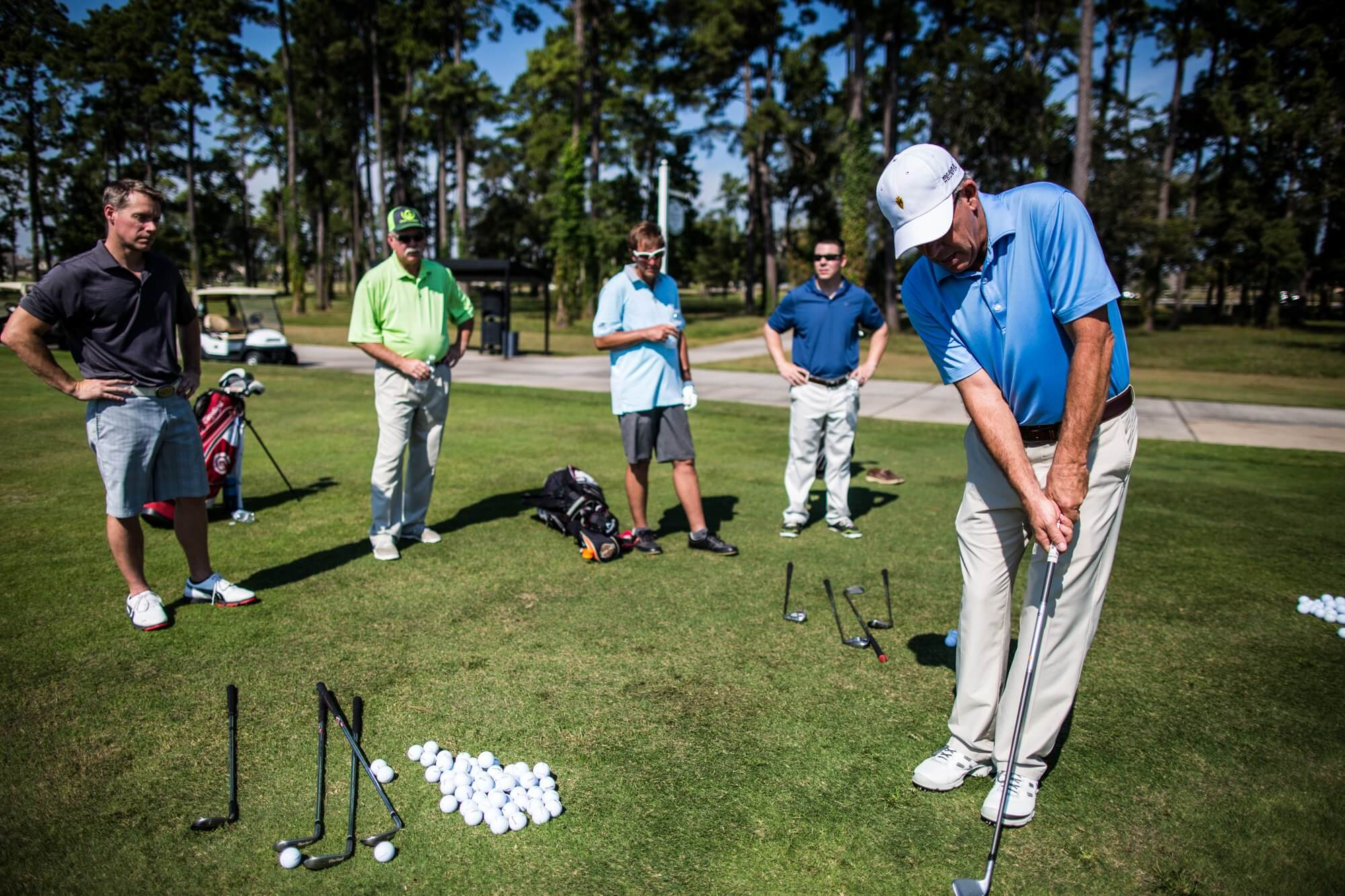 Golfers practice at the pre-tournament clinic.