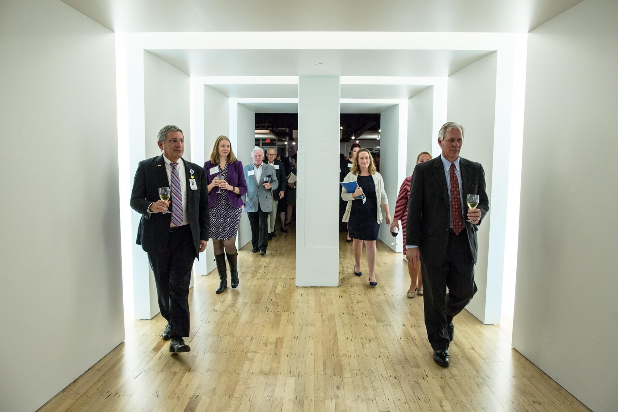 (Right to left) Paul Klotman, M.D., president and CEO of Baylor College of Medicine and Robert C. Robbins, president and CEO of the Texas Medical Center, leading the pack on a tour of TMCx.