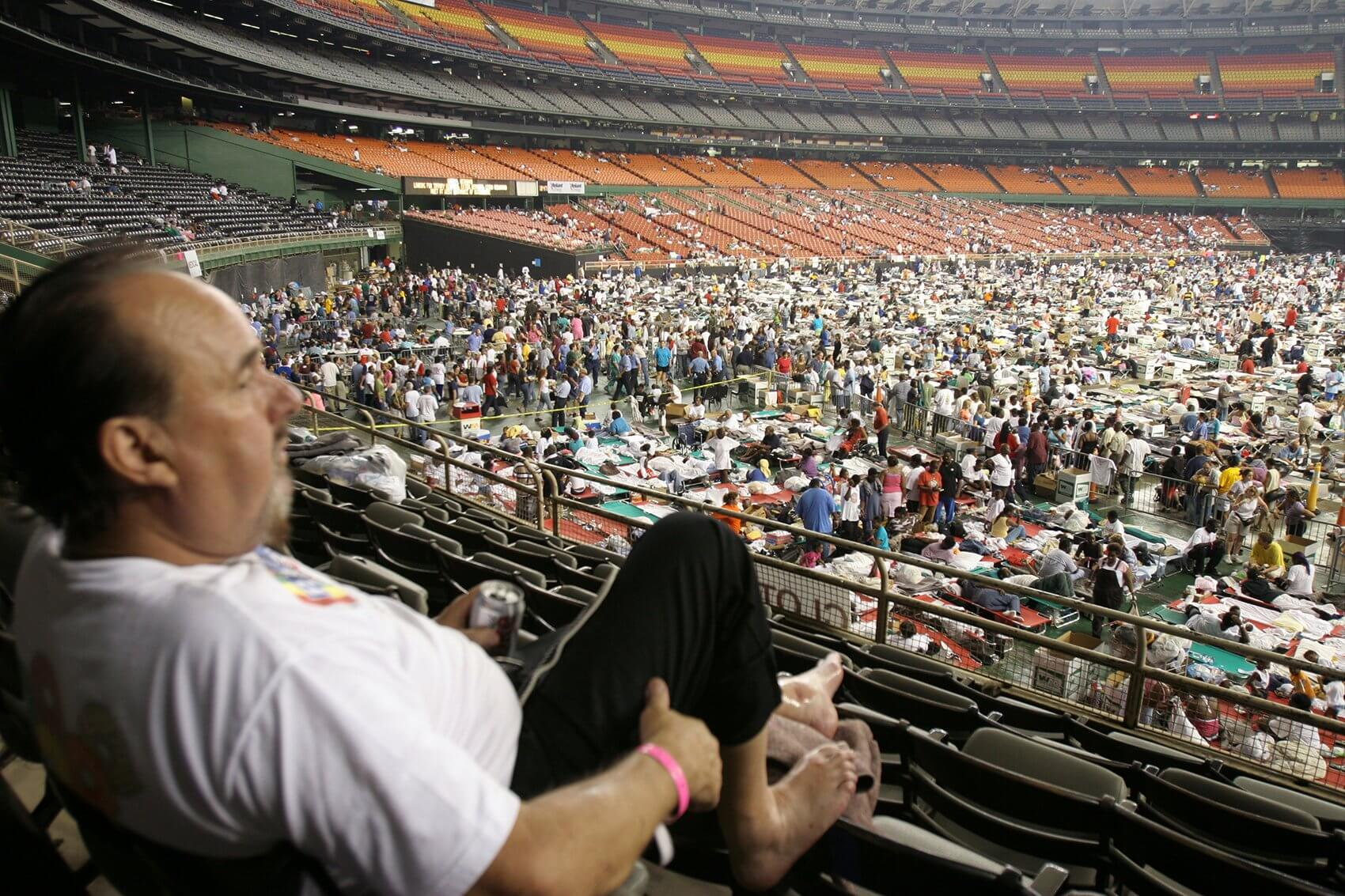 An evacuee surveys the crowd from the seats at the Astrodome. (Photo courtesy Texas Children's Hospital)