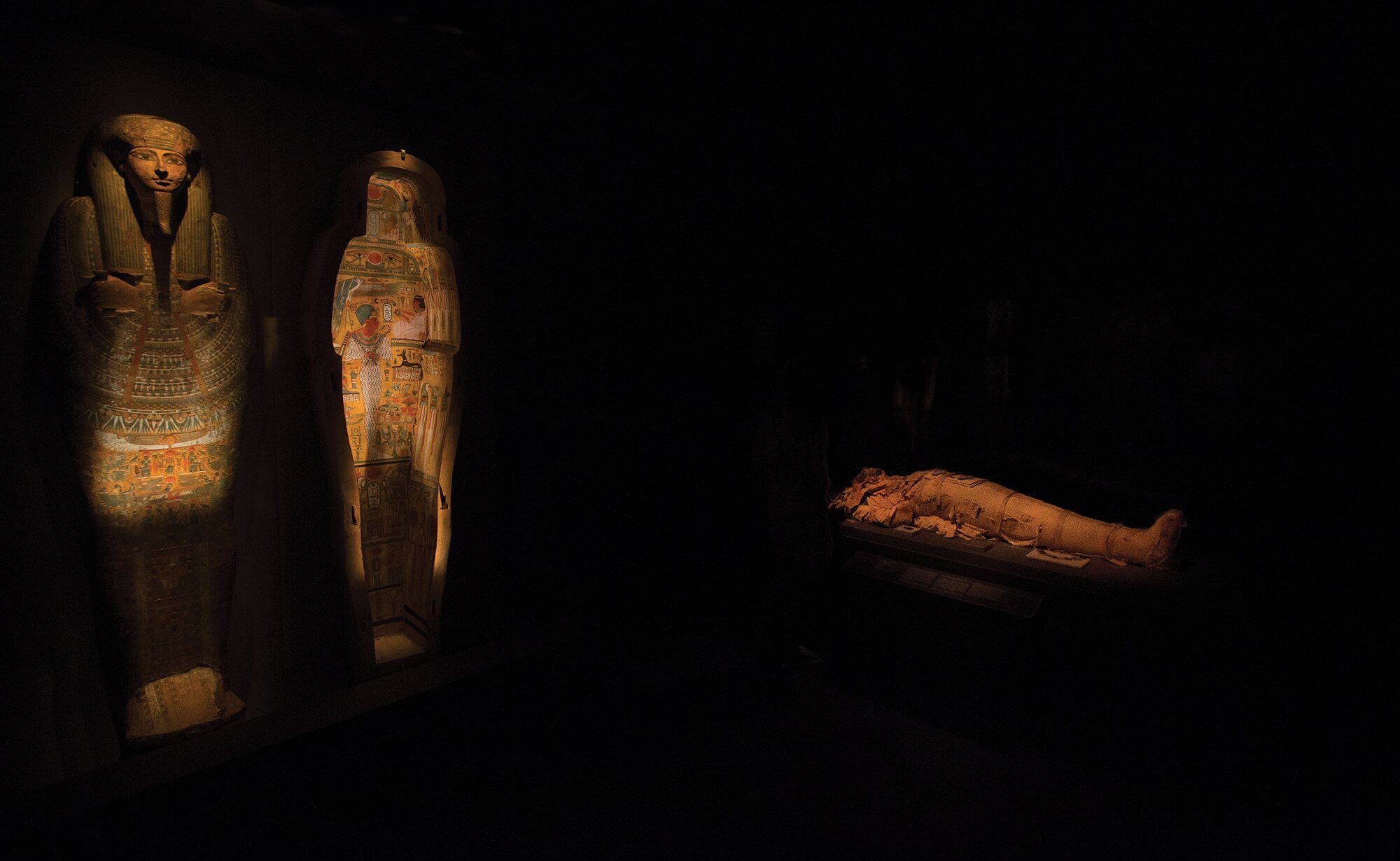 Sarcophagi and a mummy on display at the Houston Museum of Natural Science.