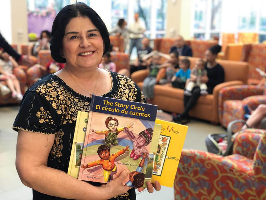 Author Diane Gonzales Bertrand read excerpts from her popular bi-lingual children's books. Photo courtesy of Ronald McDonald House Houston