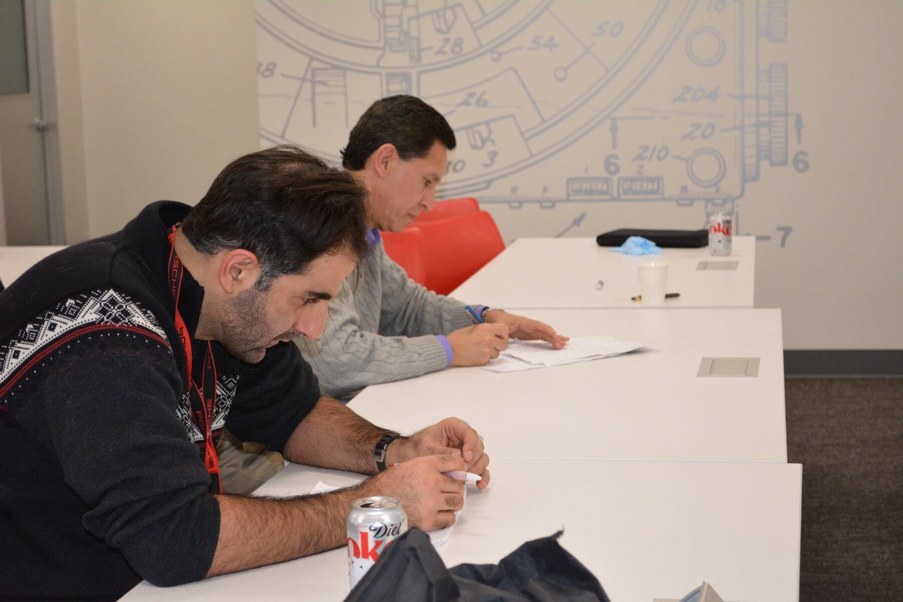 The judges included Nilson Salas, MD, right, and Ramyar Gilani, MD, both professors at Baylor College of Medicine.