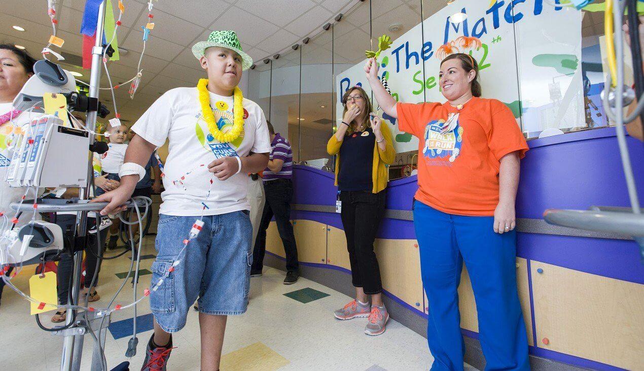Texas Children's Hospital patient Julio Cruz and Nichole Hurst (Photo credit: Allen Kramer for Texas Children's Hospital)