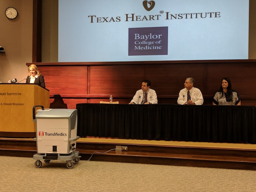 Gay Nord, market president of Baylor St. Luke's, introduces the doctors, from left, Gabriel Loor and Todd Rosengart, who led the lung transplantation for Martha Trino's (far right) husband.