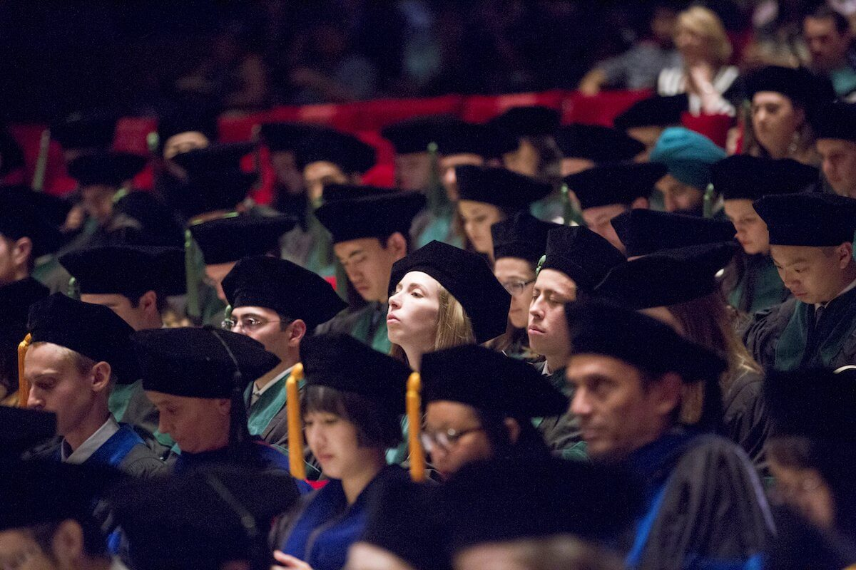 The newest doctors in Houston eagerly await the beginning of their graduation ceremony.