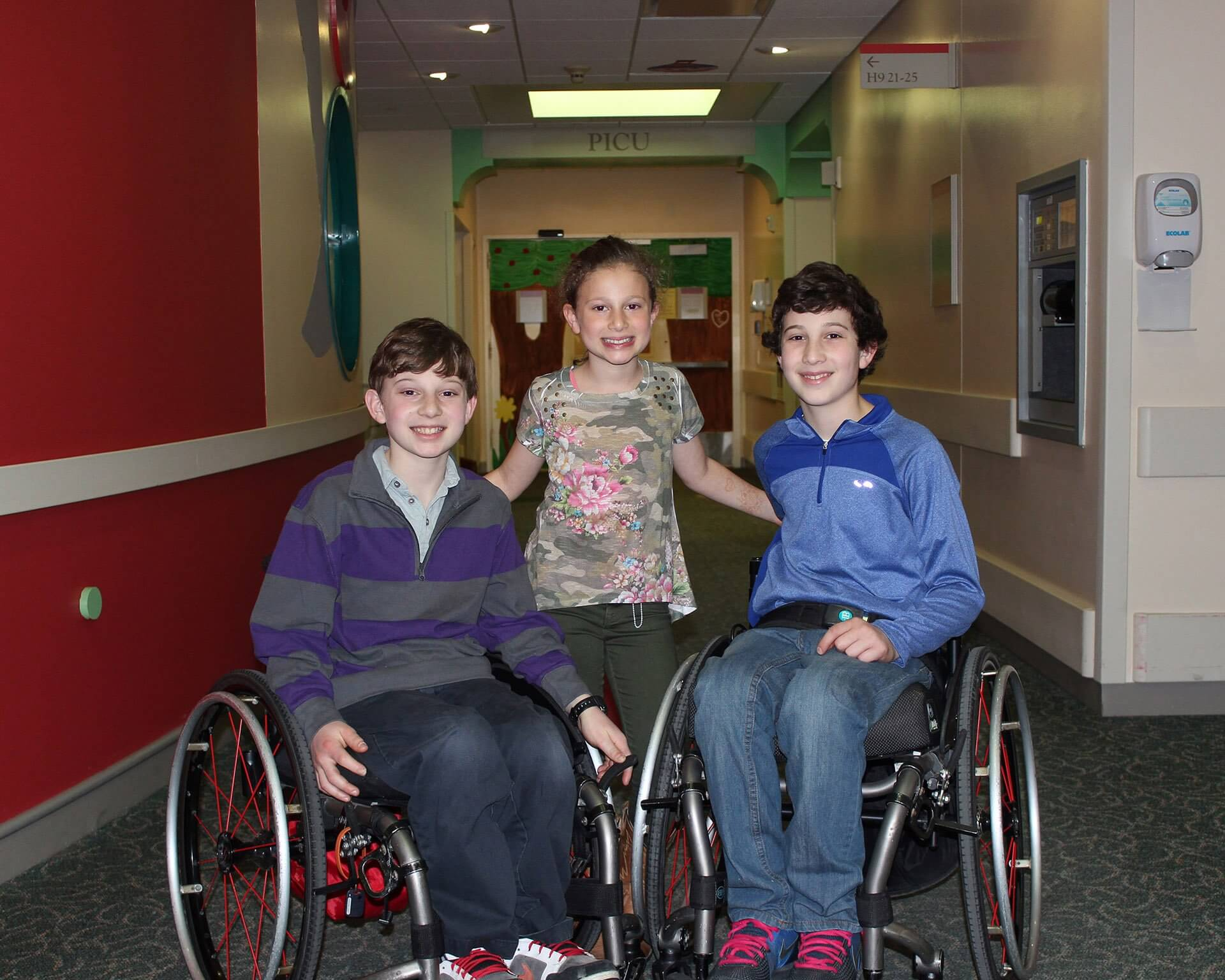 From left to right: Aaron, Willa and Peter Berry are all smiles at a recent visit to Children's Memorial Hermann Hospital