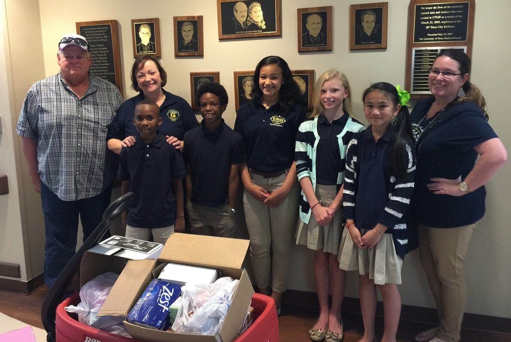 Gordon Oge (left), Debbie Oge (second-from-left) and the Guess Elementary student council as they drop off supplies to The University of Texas Medical Branch Blocker Burn Unit.