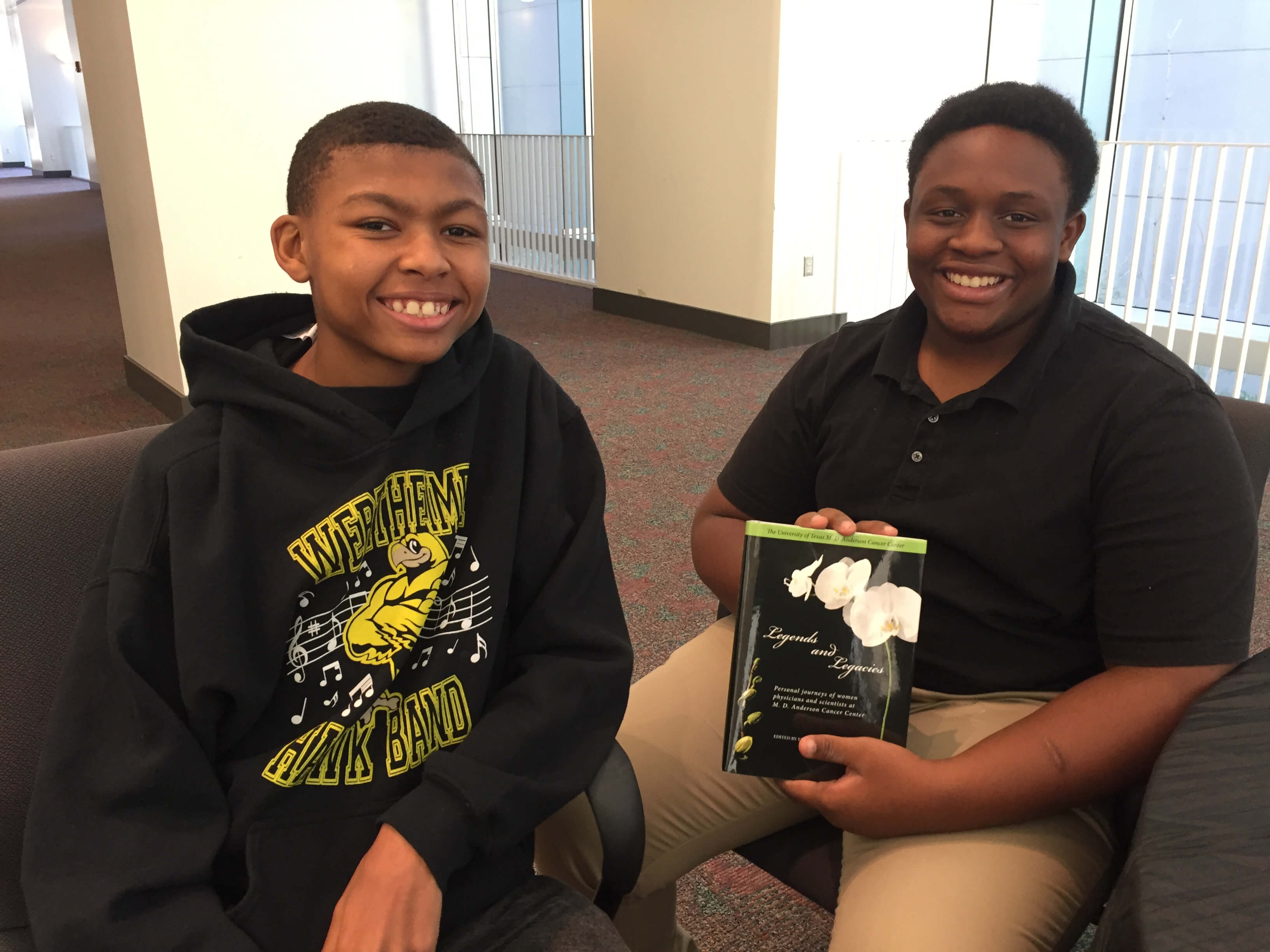 Evan Blackshear, 14, a student at Mayde Creek High School and Dmari Longmire, 15, who attends Morton Ranch High School are all smiles after the 100 Black Men of Metropolitan Houston's