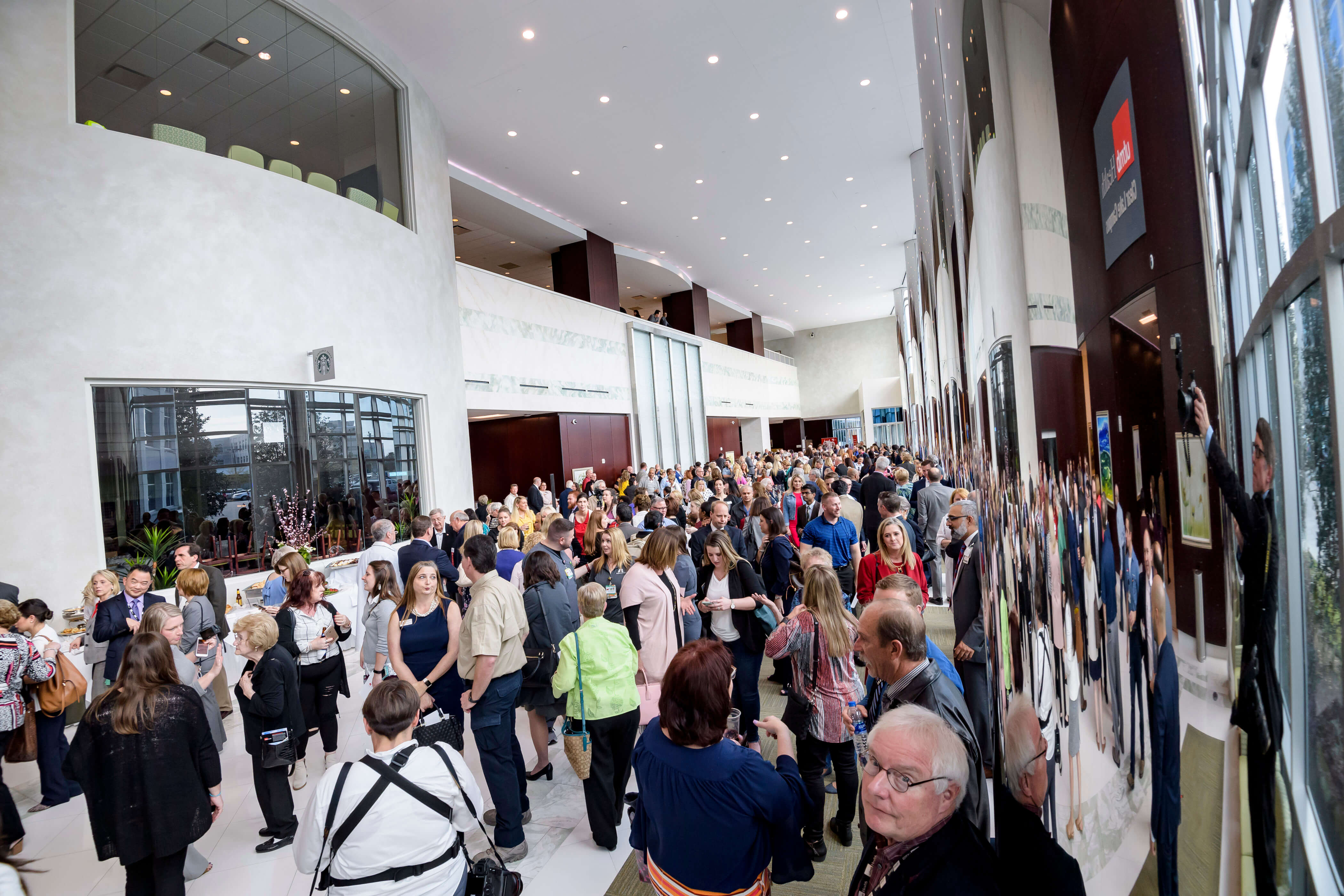 Attendees view the main floor lobby of the UTMB Health Clear Lake Campus at 200 Blossom in Webster, Texas, during the grand opening celebration on March 20, 2019.