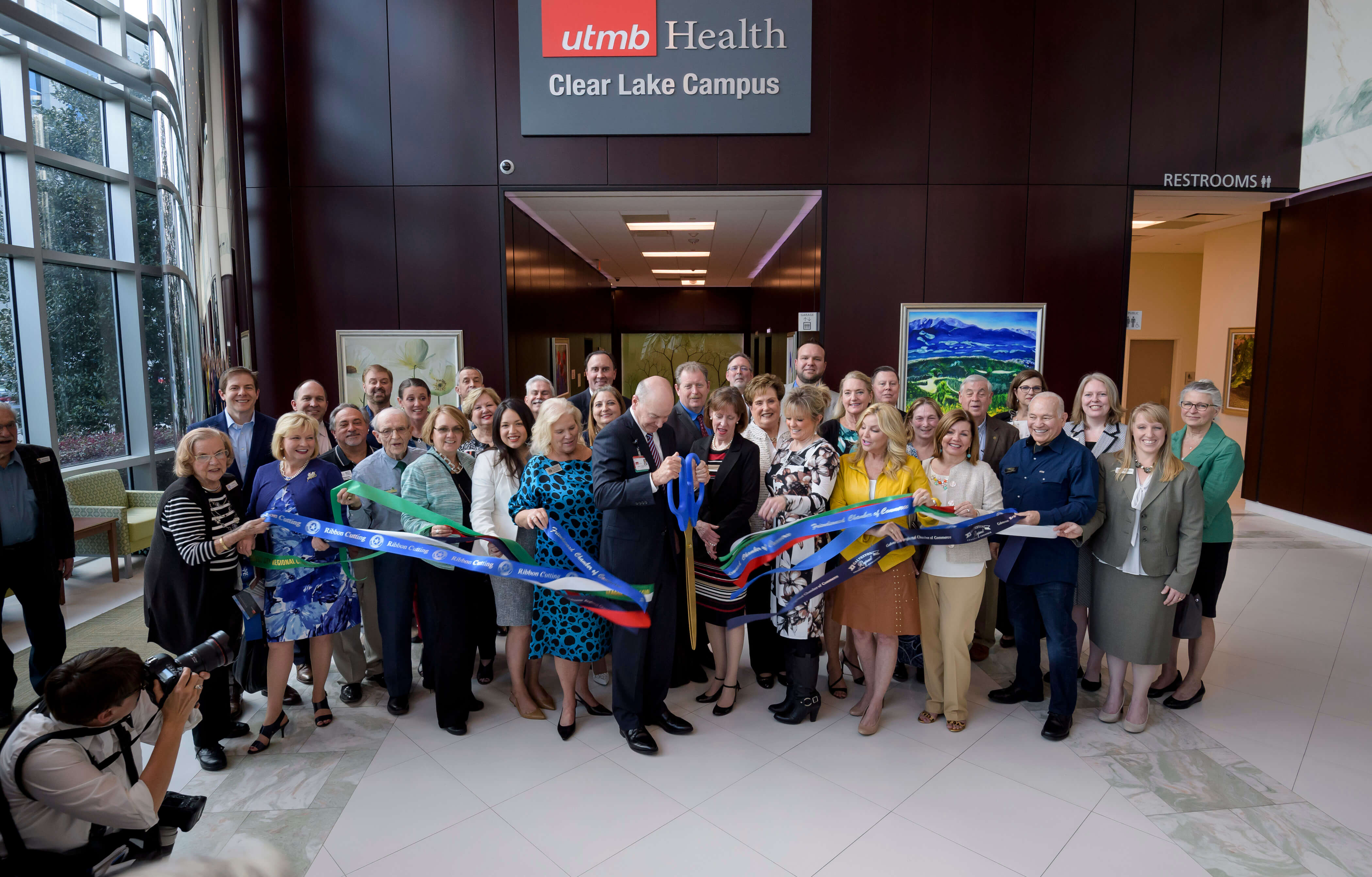 UTMB President David L. Callender, M.D., cuts the ceremonial ribbon at the UTMB Health Clear Lake Campus in Webster, Texas, during the grand opening celebration on March 20, 2019.