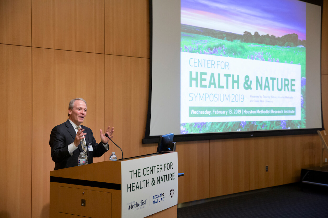Houston Methodist president and CEO Marc Boom speaks at the inaugural Center for Health and Nature Symposium.